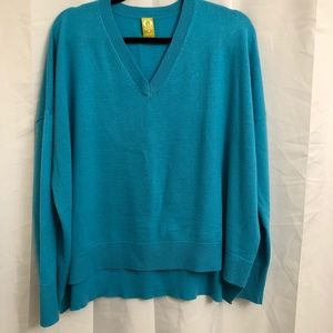 Bright blue oversize sweater.